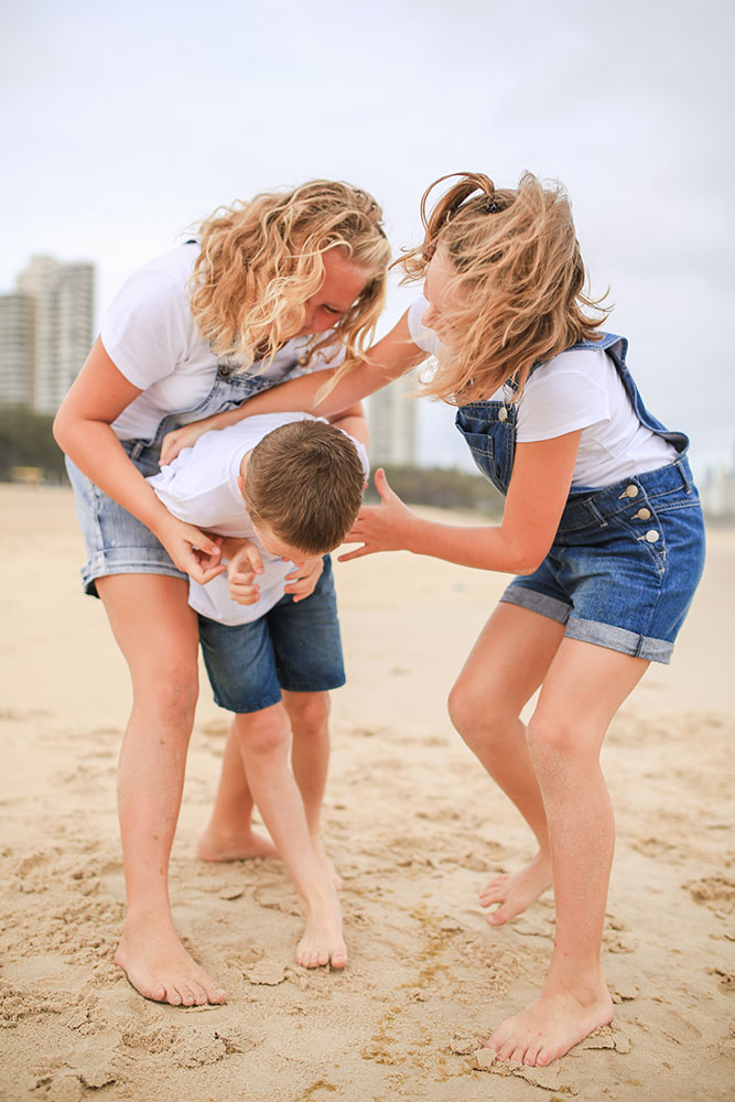 pre-teens-playing-on-the-beach-family-photography-Gold-Coast