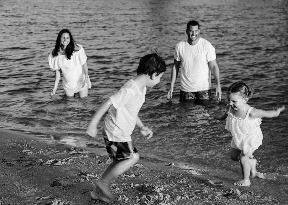 Lifestyle-Family-Photography-kids-splashing-parents-at-the-beach-Gold-coast