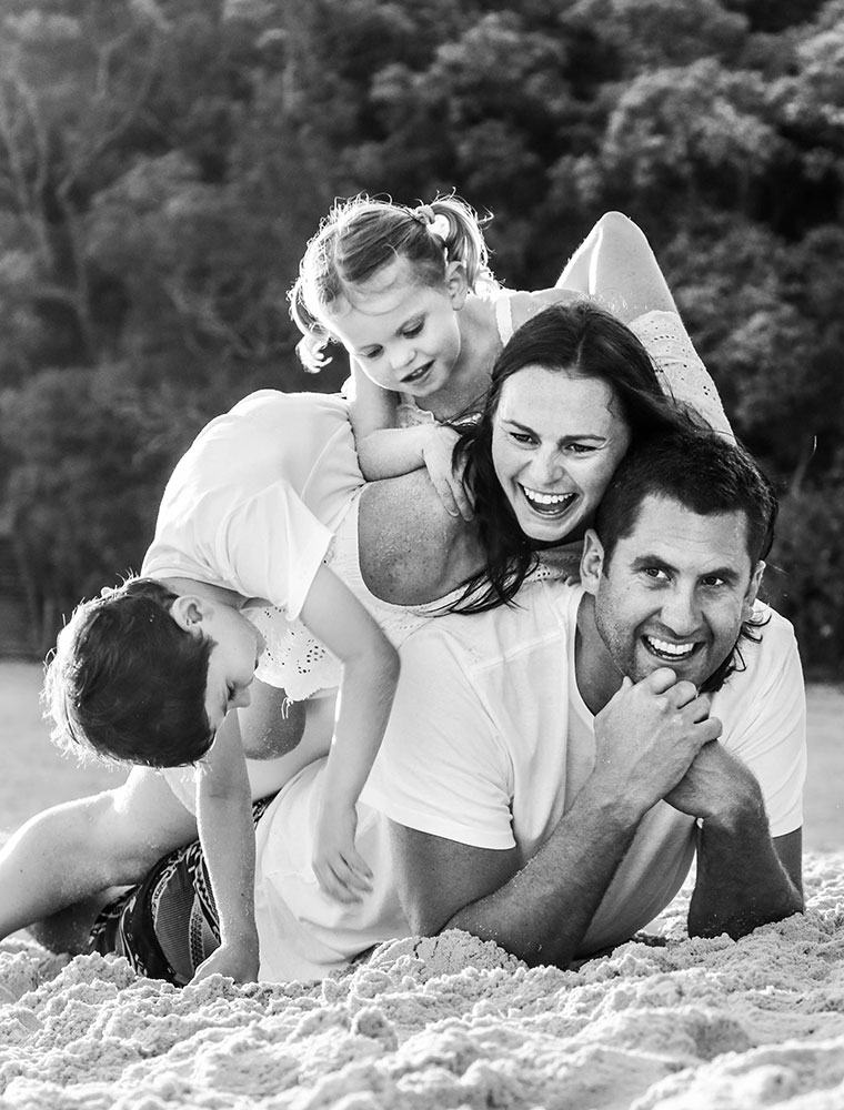 Family-playing-pile-ons-at-gold-coast-beach-family-photography