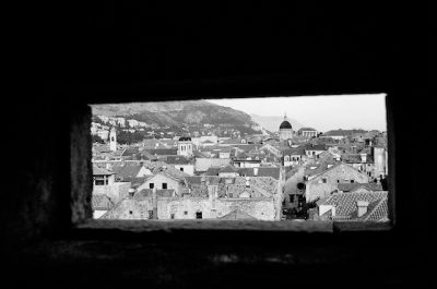 scene-of-old-town-dubrovnik-through-a-stone-window
