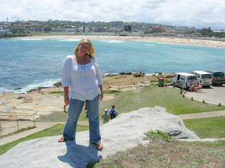 Rachel-Gold-Coast-Photographer-stands-on-rocks-infront-of-Bondi-Beach