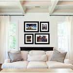 lounge room displaying 4 photography art pieces