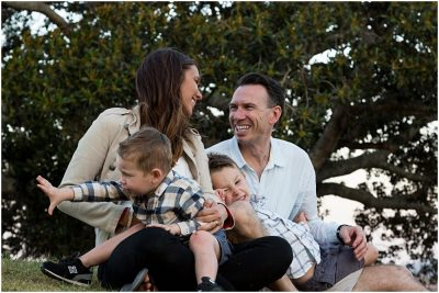 family-playing-in-the-park-parents-laughing-at-crazy-of-kids-family-photography-candid-gold-coast