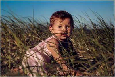 little-girl-exploring-the-beach-at-the-spit-family-photographer-gold-coast