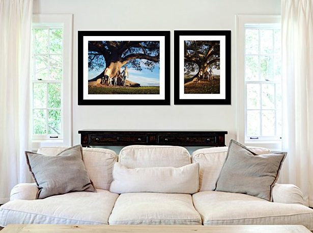 Lounge room displaying four wall art pieces of family photography