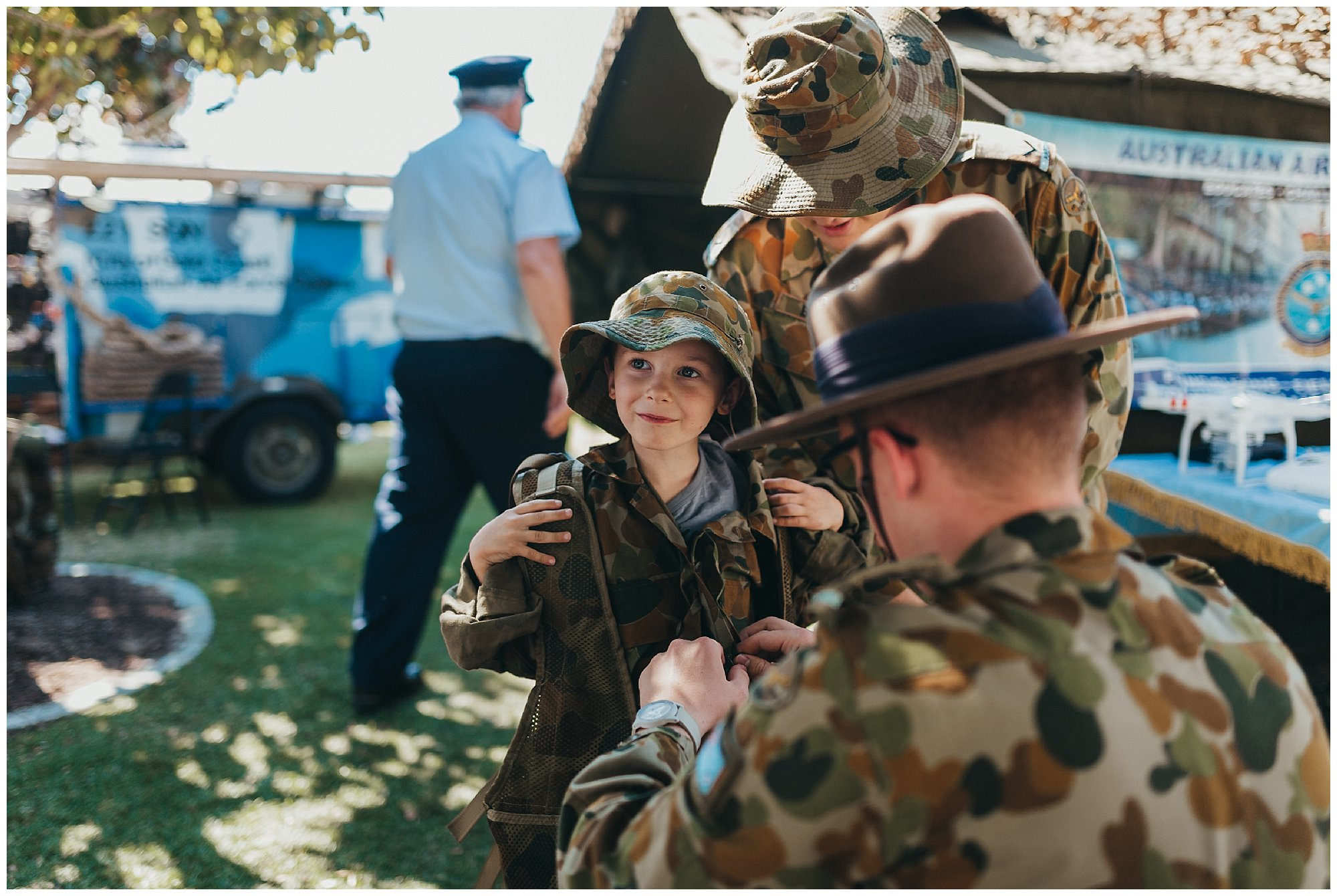 Friendly-service-men-dress-kids-up-and-show-them-military-sleeping-quarters-at-gold-coast-show