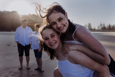 Family-playing-on-the-beach-gold-coast-teens