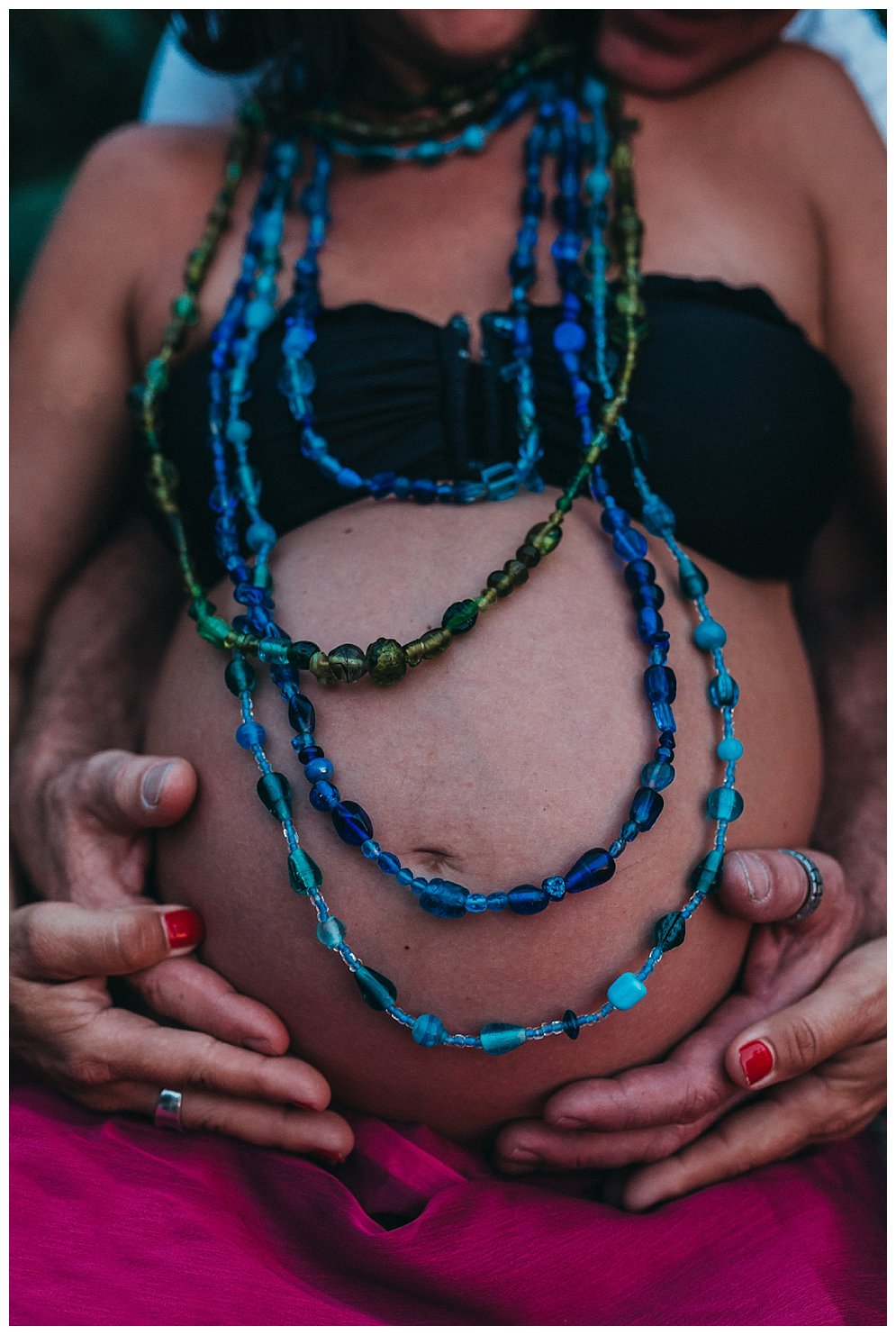 beautiful-round-pregnant-belly-with-coloured-beads-and-loving-hands-gold-coast-maternity-documentary-photography