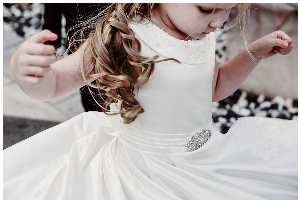 Flower-girl-twirling-in-dress-gold-coast-weddings-
