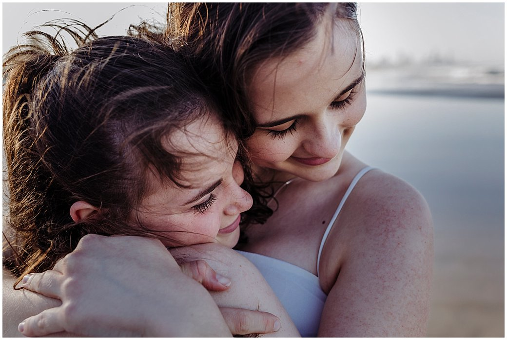 teen-sisters-cuddling-on-the-beach-gold-coast