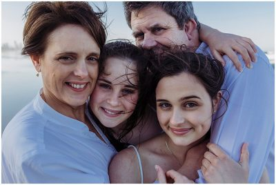Family-having-fun-together-on-the-beach-gold-coast-miami