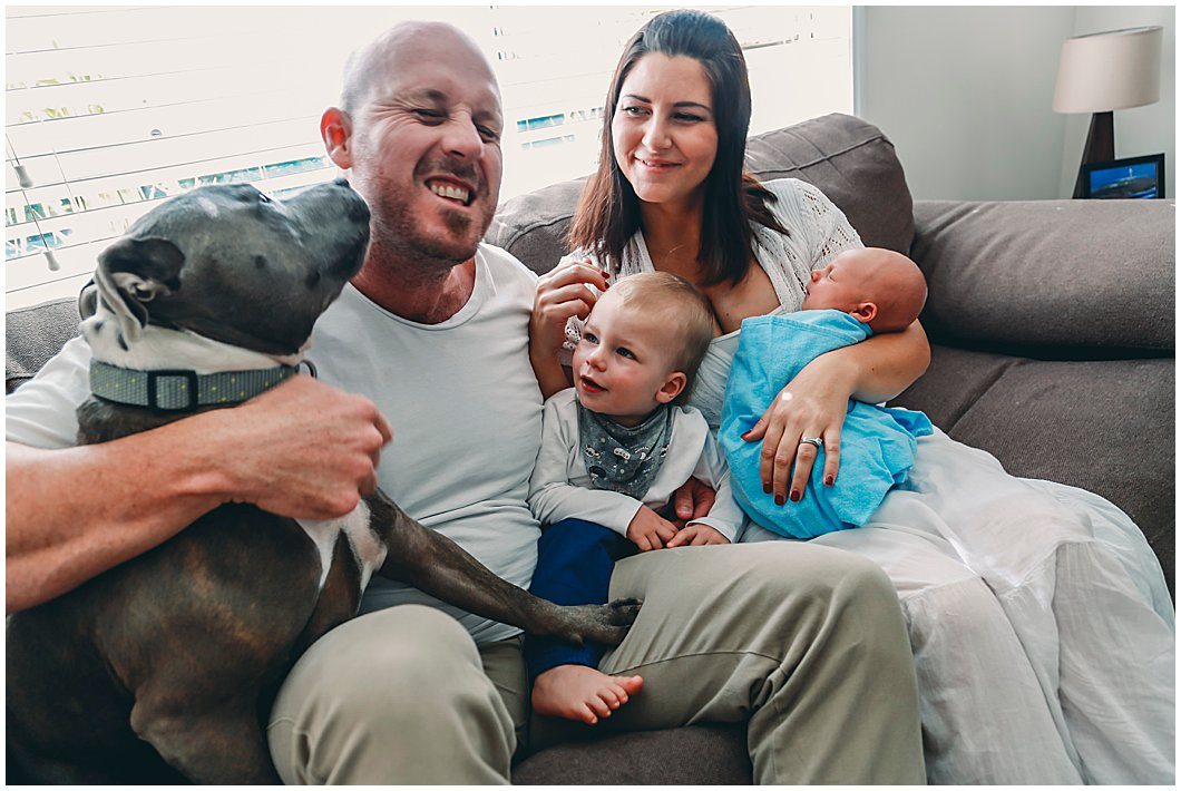 New-baby-with-family-and-dog-licking-dad-with-toddlers-laughing-gold-coast-inhome-newborn-photography