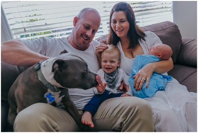 energetic-dog-joins-family-on-the-couch-for-inhome-newborn-photography-session-gold-coast-and-brisbane