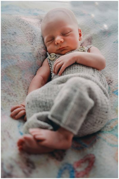 Newborn-baby-snoozing-in-cute-knitted-outfit-gold-coast-newborn-documentary-photography