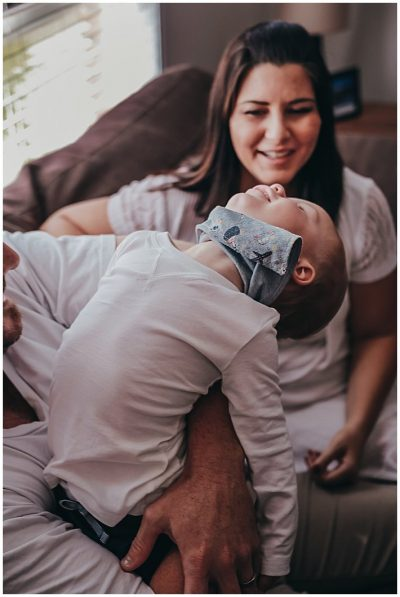 toddler-leaning-back-in-play-with-parents-gold-coast-family-photography