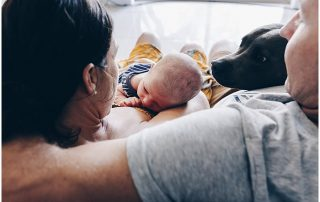 dog-sniffing-newborn-baby-whilst-parents-snuggle-gold-coast-newborn-candid-photography