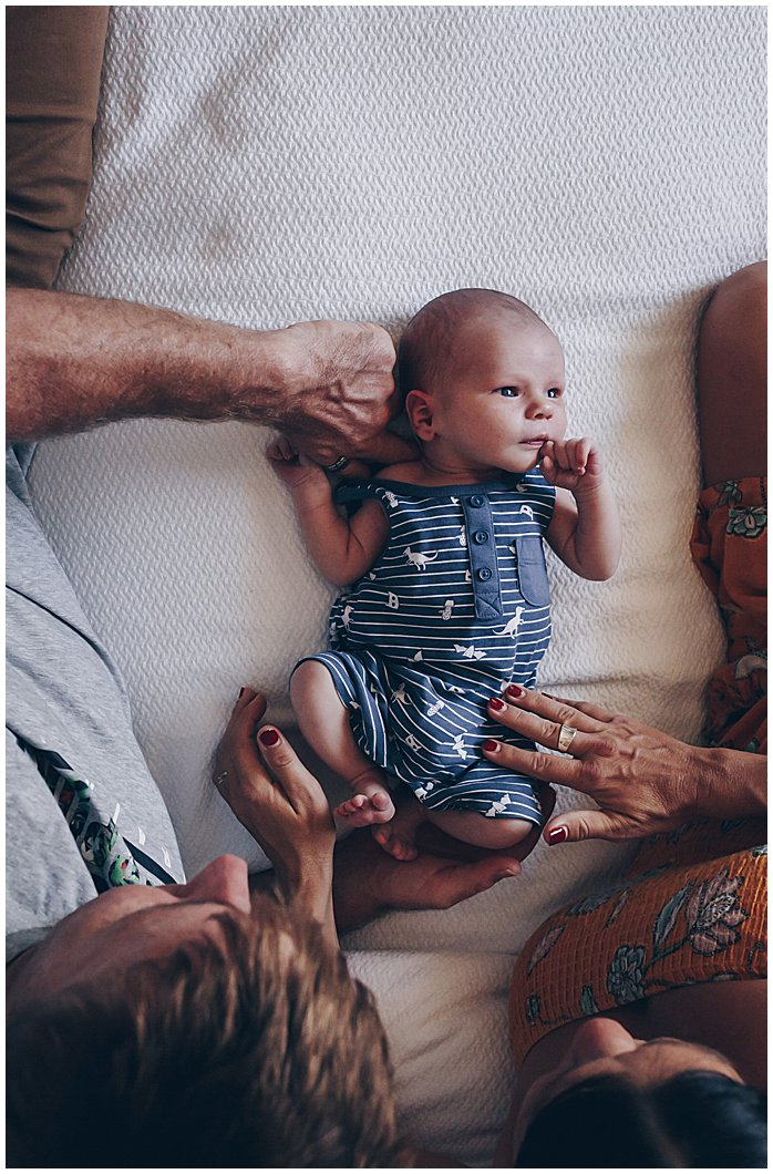 Beautiful-scene-of-newborn-laying-on-bed-being-looked-on-and-loved-by-mum-and-dad-gold-coast
