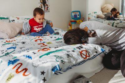 Family-documentary-short-story-session-mother-and-son-playing-on-the-bed-gold-coast