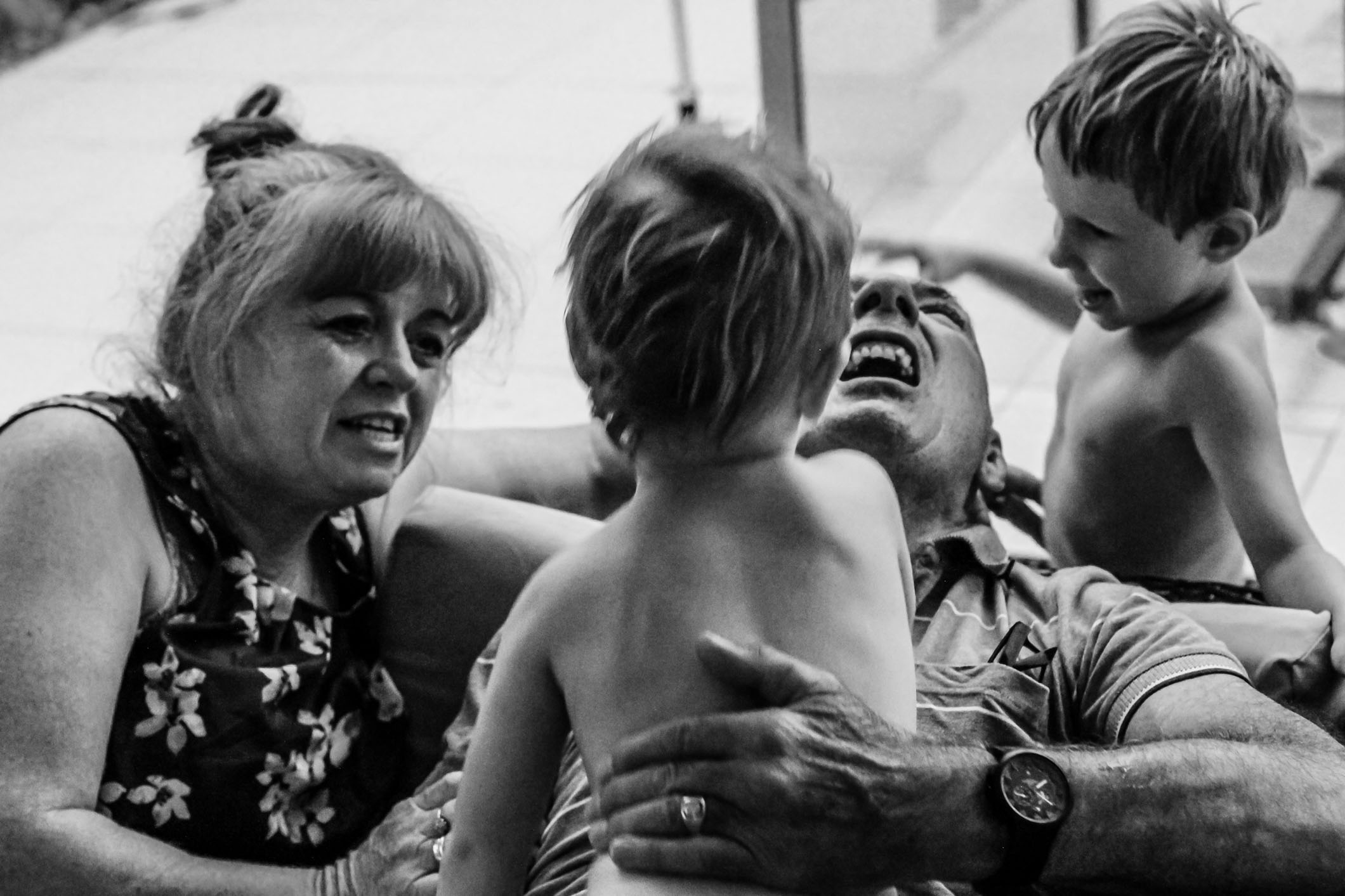 Grandparents-wrestling-with-grandchildren-family-documentary-photography-gold-coast