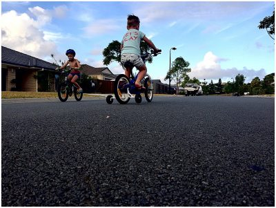 two-boys-on-bike-and-scooter-riding-out-the-front-of-their-house-gold-coast-short-story-telling-photography