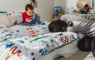 Family-documentary-mother-playing-with-son-on-the-bed
