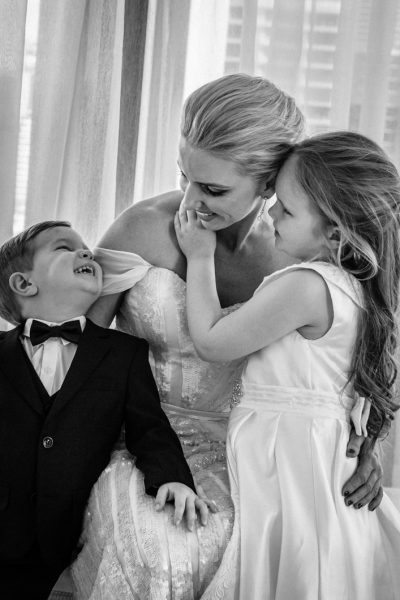 Chidren-cuddling-their-beautiful-bride-mother-before-walking-down-the-aisle-gold-coast-family-documentary-wedding-photography