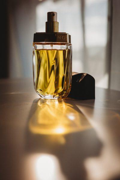 blog-image-of-carol-weber's-favourite-perfume-knowing-estee-Lauder-stunning-golden-light-shinning-through-bottle