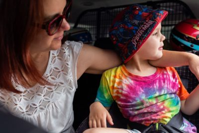 young-boy-showing-mum-the-sights-together-in-the-backseat-of-the-car