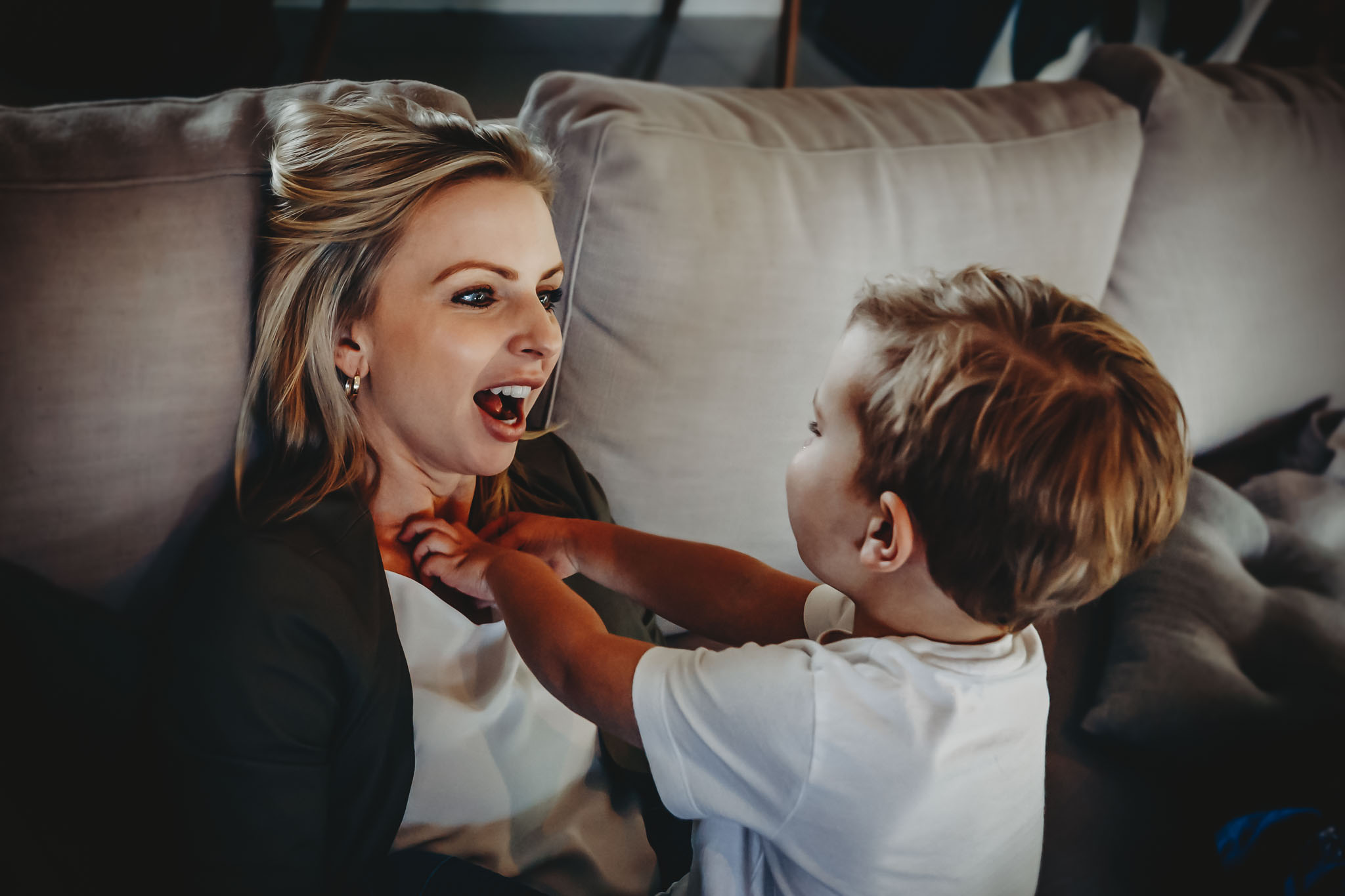 blog-image-young-boy-plaing-on-couch-with-mum-tickling