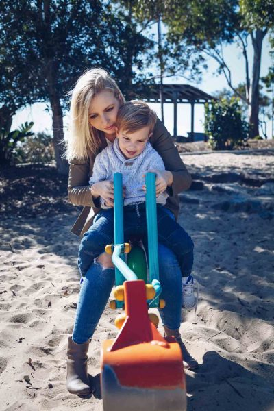Mum-and-son-moment-playing-on-the-crane-in-the-sand-at-the-park-gold-coast-family-lifestyle-photography-feather-touch-photography