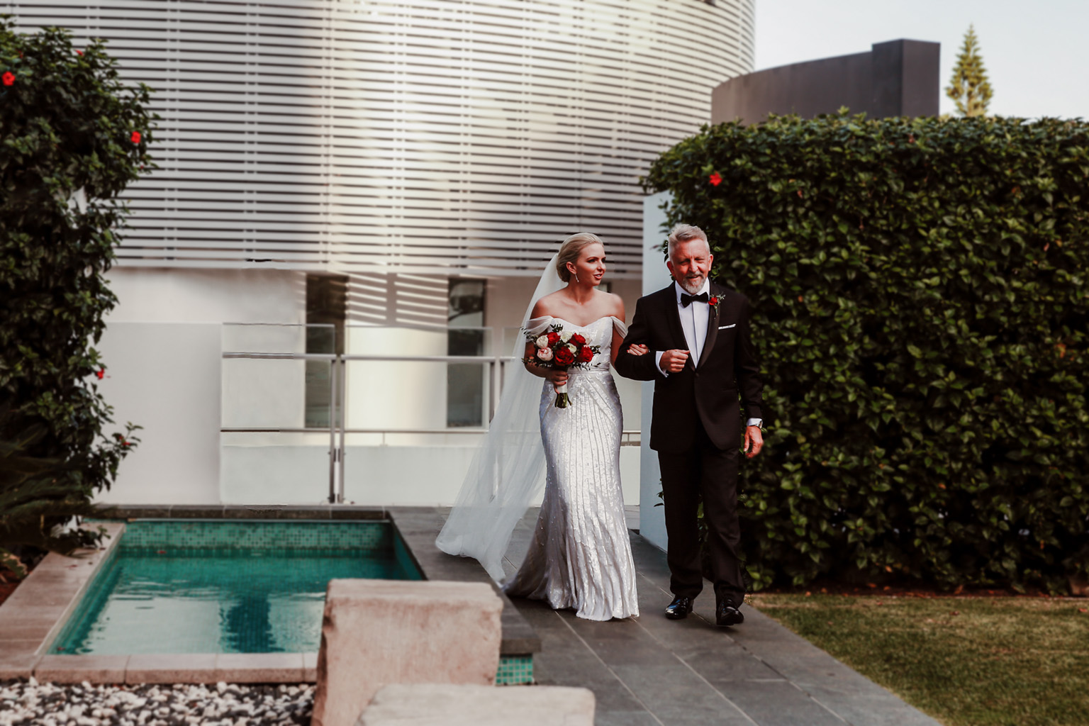 blog-image-Bride-being-walked-down-the-aisle-by-her-dad-Peppers-Garden-Terrace-gold-coast