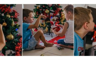 Image-of-a-photo-album-of-young-family-putting-up-the-xmas-tree